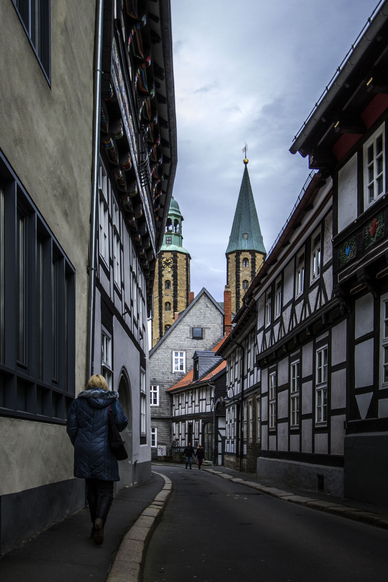 Goslar, Germany Architecture Building Exterior Built Structure Casual Clothing Church City City Life Cloud Day Full Length Germany Goslar Goslar Germany Battle Of The Cities In Front Of Lifestyles Old Town Outdoors Person Place Of Worship Religion Sky Street The Way Forward Tourism