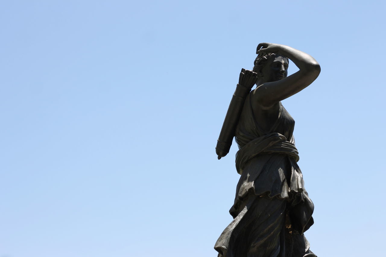 statue, sculpture, human representation, low angle view, blue, clear sky, outdoors, no people, day, sky, memorial