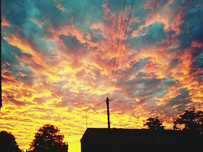 Sunset Silhouette Tree Low Angle View Built Structure Architecture Building Exterior Sky High Section Cloud - Sky Orange Color Cloud Power Line  Outdoors Electricity Pylon Scenics Cable Outline Beauty In Nature Dramatic Sky