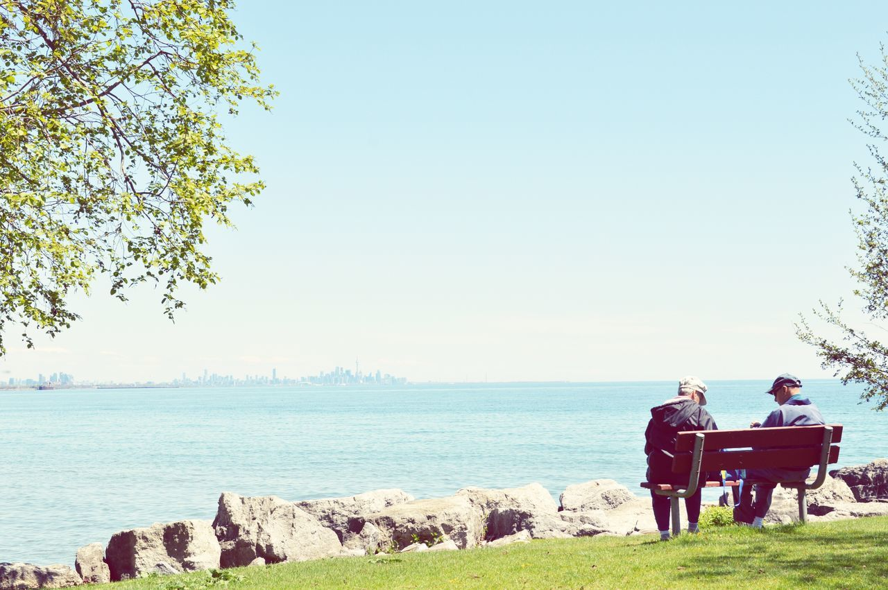 Some quality time By The Lake Lakeshore Waterfront Older Couple Bench Park Leisure Time Mississauga Port Credit Toronto Skyline Blue Water