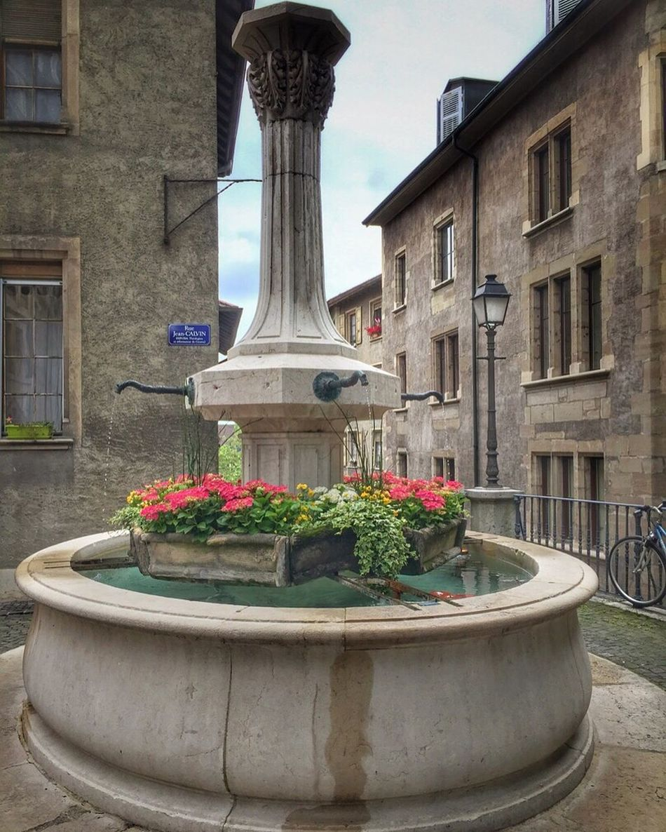 Traditional Swiss fountain with flowers in old town Geneva Fountain Swiss Fountain Flowers Old Town Geneva Geneve Suisse  Switzerland Schweiz Svizzera Water Schweizerlland