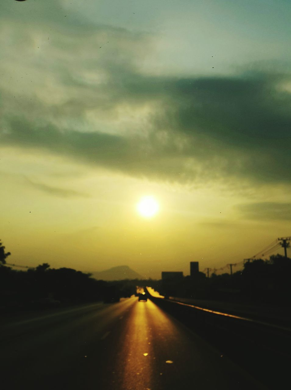 sunset, road, transportation, sky, sun, the way forward, car, no people, nature, drop, cloud - sky, land vehicle, outdoors, scenics, beauty in nature, tree, day
