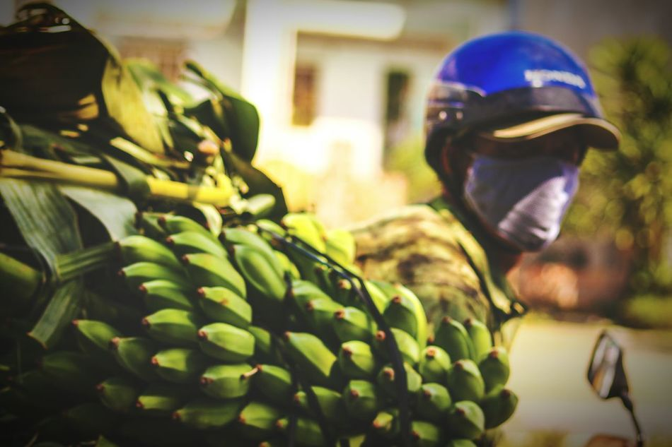 Qhuy Nhon, Vietnam Working One Person Market Green Bananas Carrying Things On The Motorbike Overloaded People Photography Street Photography Travel Travel Photography EyeEm Best Shots Real People People Tourism