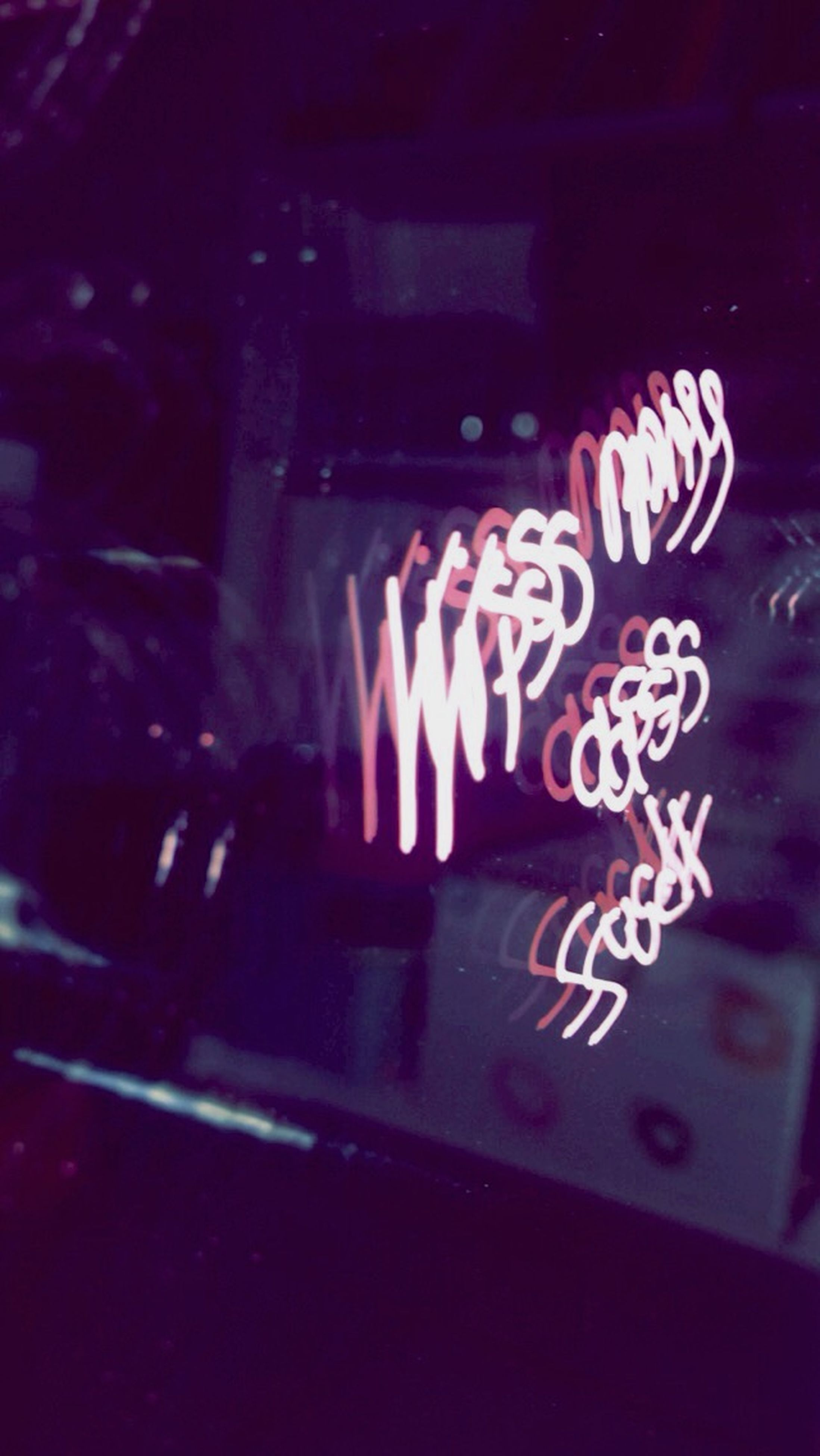 indoors, illuminated, night, flame, burning, arts culture and entertainment, fire - natural phenomenon, glowing, art and craft, celebration, close-up, heat - temperature, light - natural phenomenon, art, creativity, candle, multi colored, motion, dark