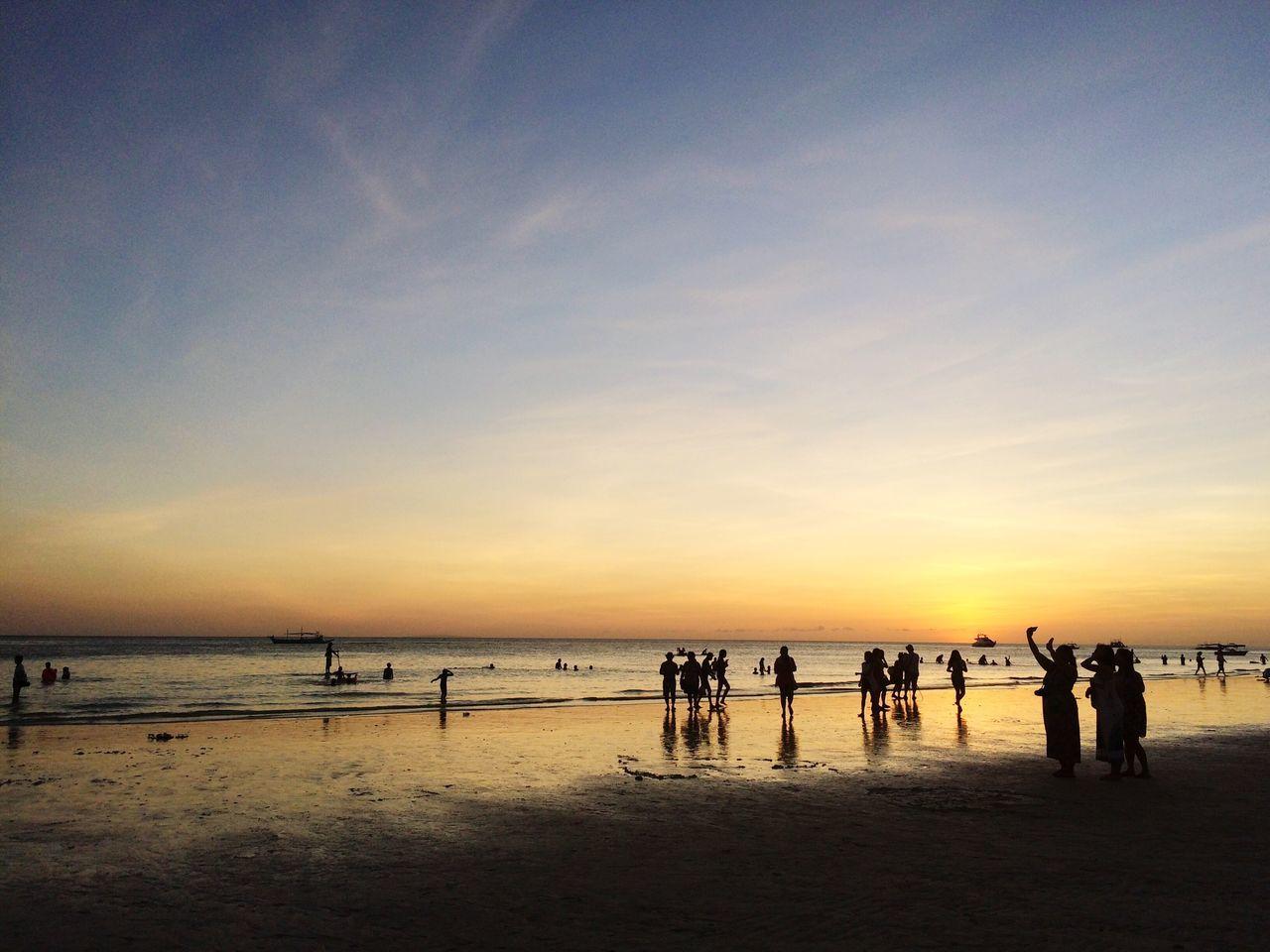 Tourists Enjoying At Sunset