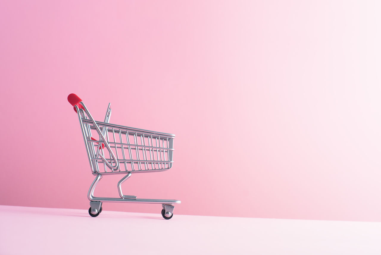 Cart Commerce Concept Conceptual Copy Space Copy Space Downward Empty Fall Falling Grocery Grocery Shopping Market Negative Space Pink Pink Background Retail  Sale Shop Shopping Shopping Cart Store Supermarket Symbol Trolley