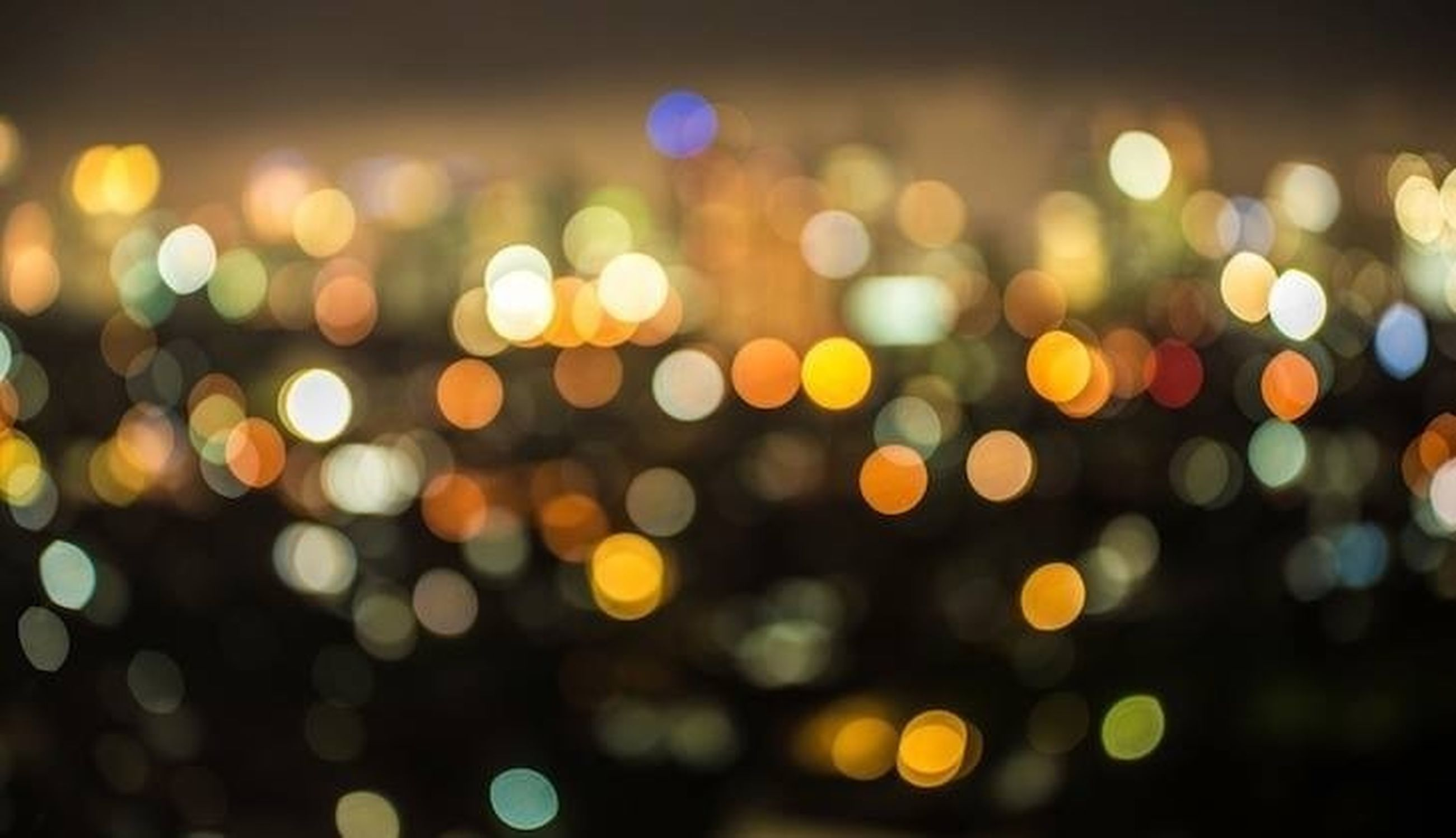 illuminated, night, defocused, lighting equipment, multi colored, light - natural phenomenon, glowing, city, lens flare, light, circle, no people, street, abstract, outdoors, backgrounds, blurred motion, pattern, long exposure, full frame