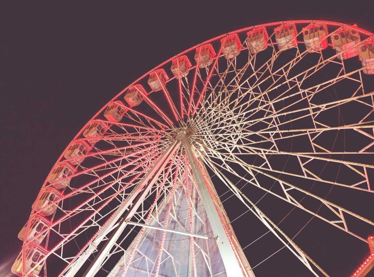Ferris Wheel Arts Culture And Entertainment Low Angle View Amusement Park Night Illuminated Sky No People Clear Sky Outdoors Motion Amusement Park Ride Cultures Big Wheel Tourism Low Angle View Architecture Geometric Shape Futuristic Modern