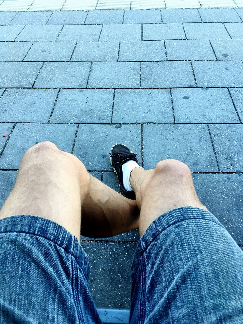 low section, human leg, jeans, one person, personal perspective, human body part, casual clothing, one man only, shoe, real people, sitting, men, only men, lifestyles, outdoors, day, adult, adults only, people, human hand