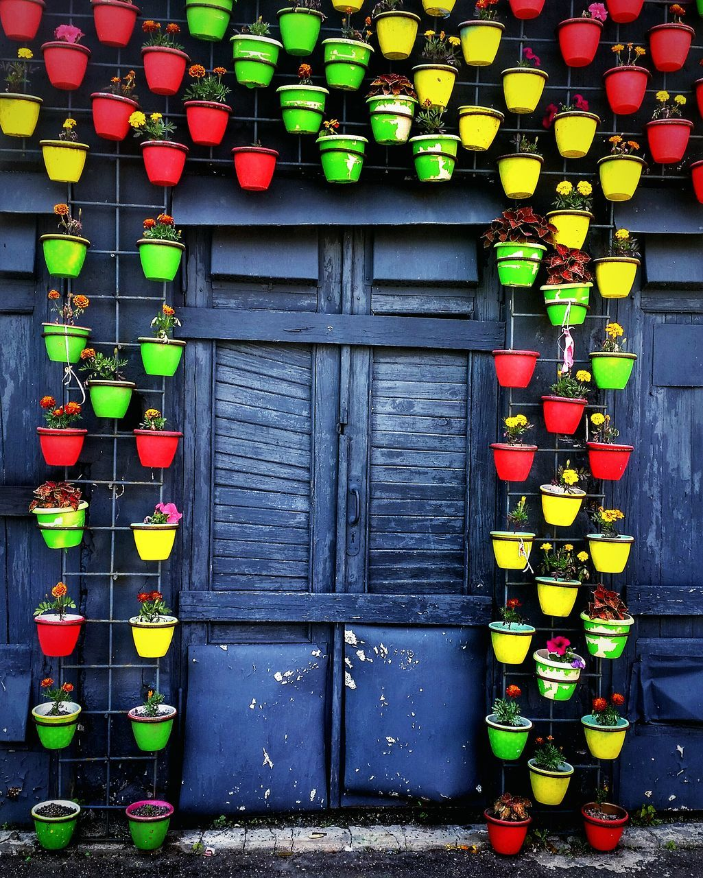in a row, multi colored, no people, lantern, hanging, built structure, outdoors, day, architecture, large group of objects, red, building exterior