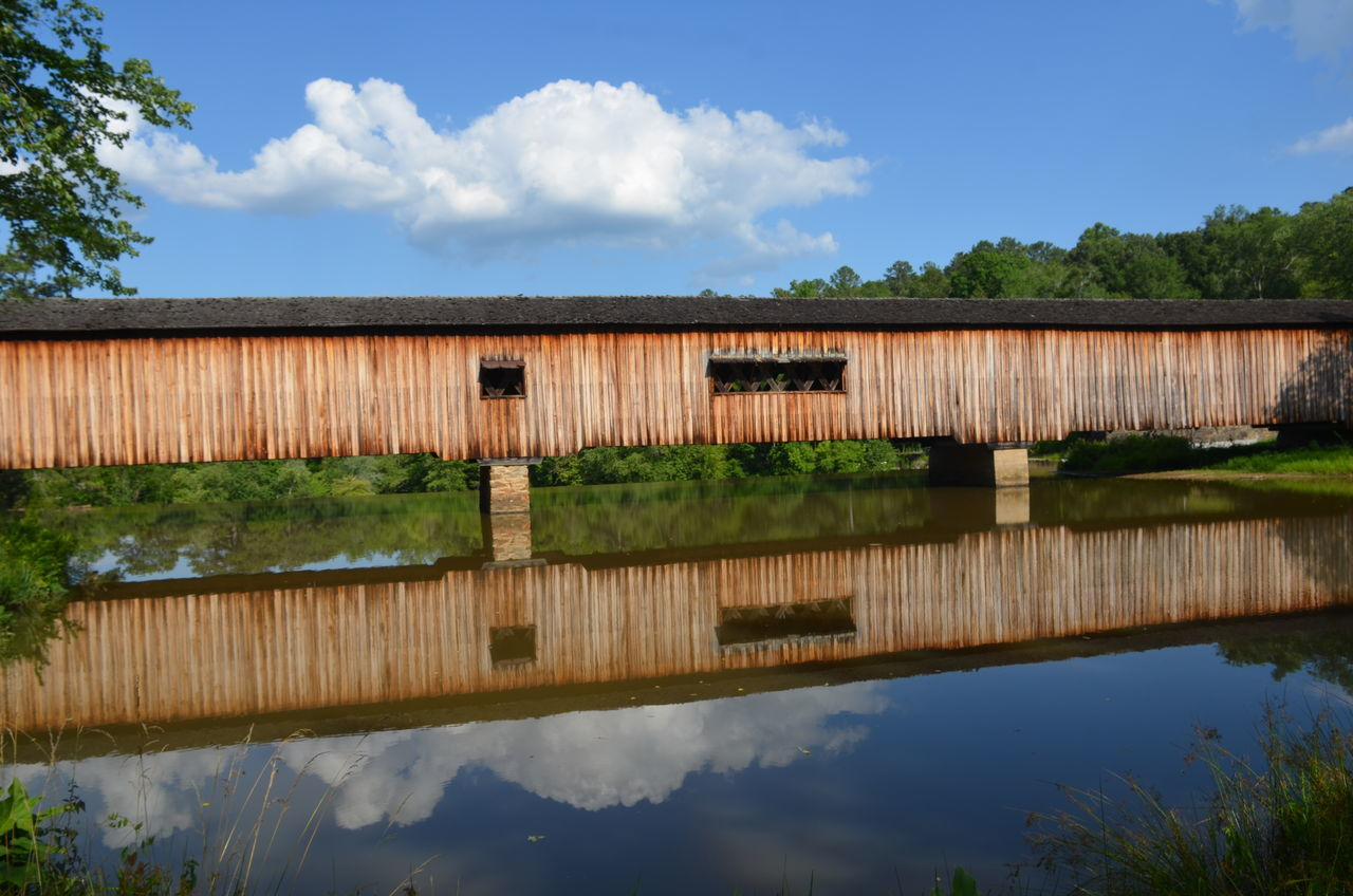 Architecture Beauty In Nature Building Exterior Cloud - Sky Covered Bridge CoveredBridge Day Growth Lake Nature No People Outdoors Plant Reflection Rural Scene Scenics Sky Tranquil Scene Tranquility Tree Water The Architect - 2017 EyeEm Awards