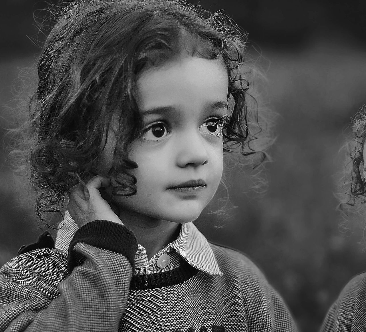 childhood, elementary age, girls, real people, innocence, headshot, child, one person, close-up, boys, focus on foreground, outdoors, day, children only, lifestyles, portrait, people