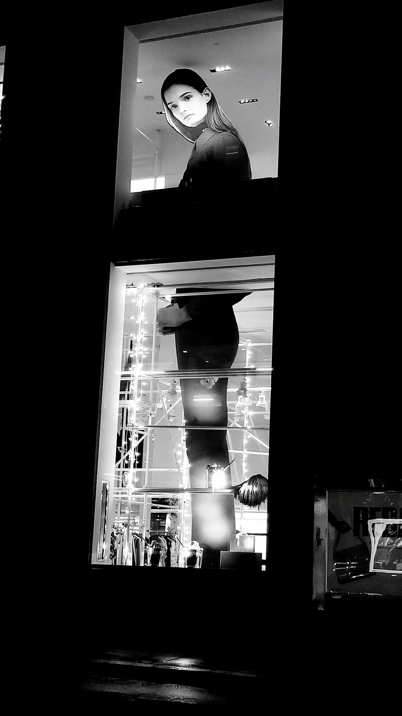 Large prinnt of model in store window