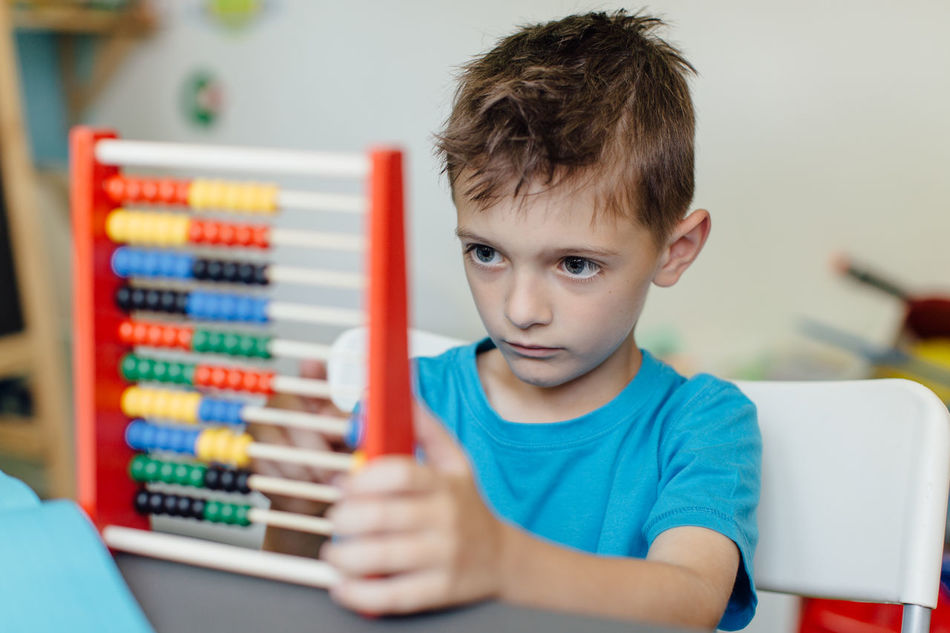 Focused schoolboy learning maths with an abacus Abacus Assignment Boy Caucasian Child Counting Critical Home Homeschooling Homework Independent  Kid Learn Learning Mathematics Maths Project Room School Schoolboy Schoolchild Solitary Student Thinking Young