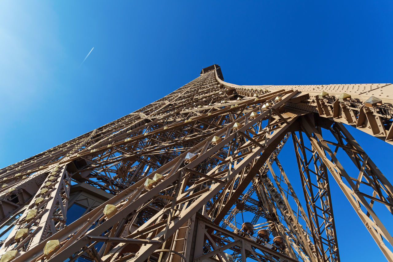 Eiffel Tower in Paris, bottom view against clear blue sky Architecture Blue Sky Built Structure Capital City Eiffel Tower Famous Place Famous Places High Low Angle View Metalwork No People Outdoors Rat View Sky Steel Steel Structure  Tall Tourism Tourist Attraction  Tower Travel Destnations Unusual Visit