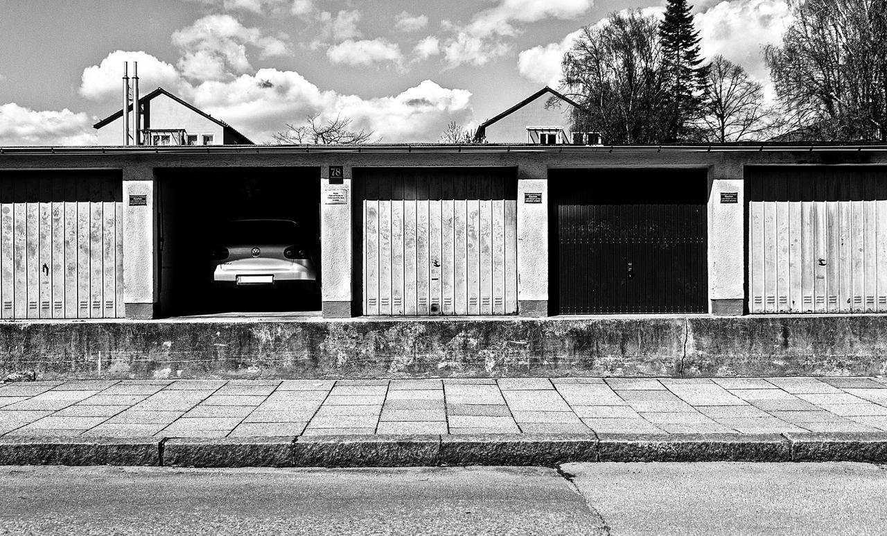 Architecture Car Cloud Day Empty Garage Garage Door Garage Doors Lines No People Outdoors Paralell Parking Parking Garage Street