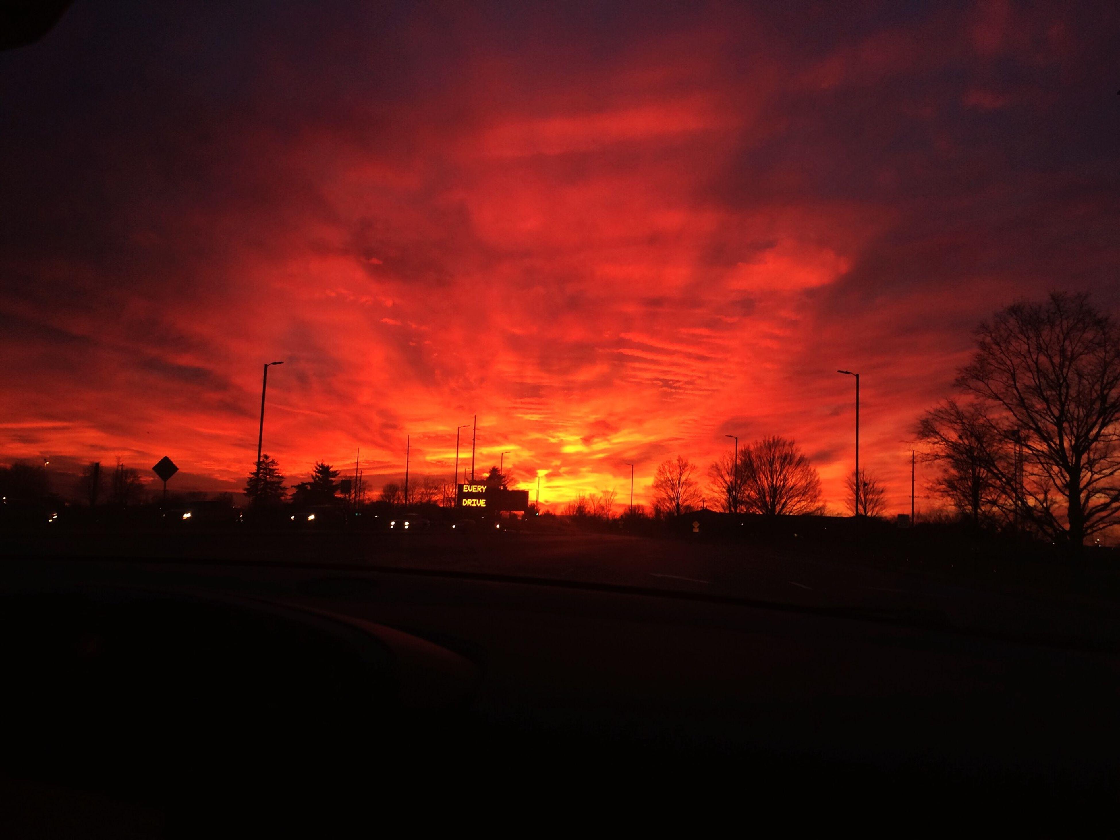 sunset, silhouette, orange color, transportation, sky, road, car, cloud - sky, scenics, beauty in nature, dramatic sky, tree, land vehicle, dark, tranquil scene, landscape, tranquility, nature, street, sun