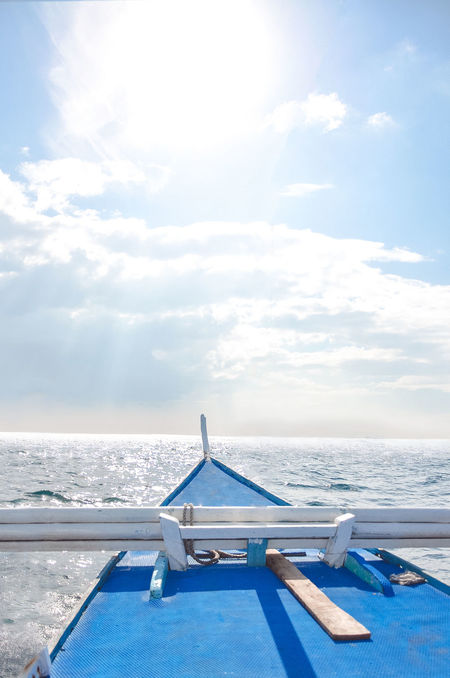 Ocean and blue sky view from a boat Beautiful Blue Boat Bow Cruise Deck Front Horizon Lifestyles Luxury Ocean Sail Sailing Sea Ship Sky Sport Travel Vacation View Water Wave White Yacht Yachting