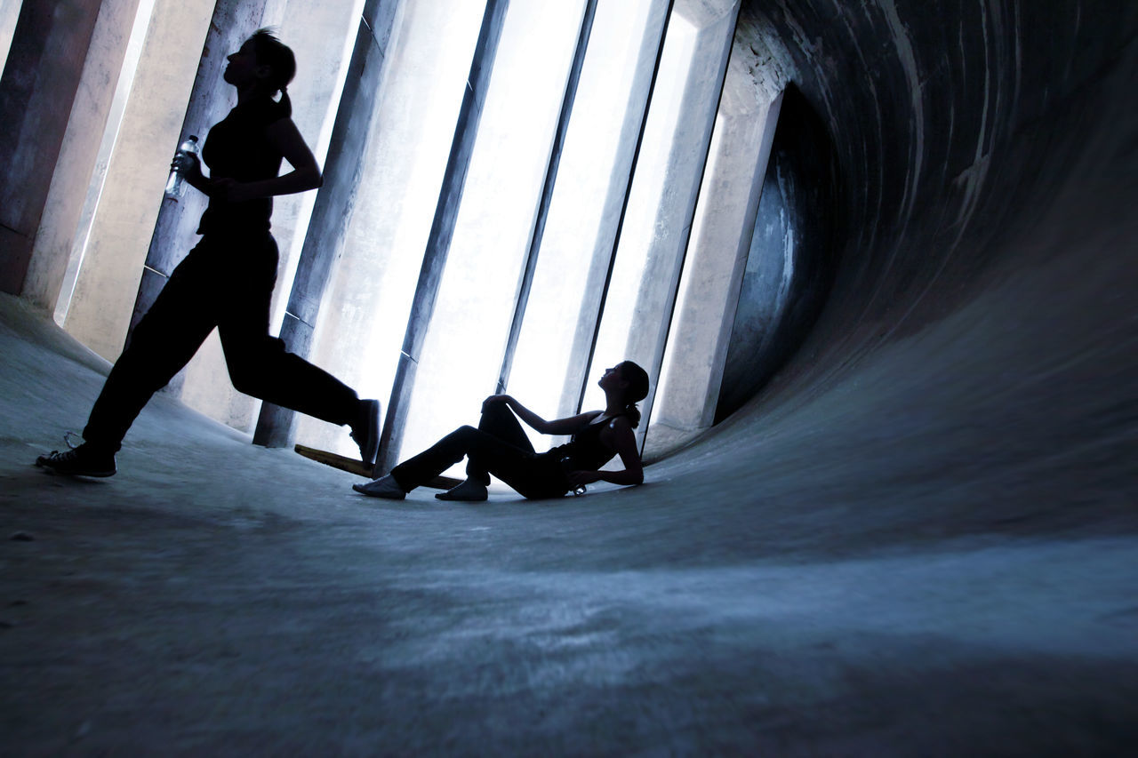 Two Women working out in an old abandoned Wind Tunnel: Futuristic Running action action shot Dark darkness and light EyeEmNewHere Futuristic healthy lifestyle jogging Jogging time lifestyles Modern motion capture people Running sports wind tunnel women Women Who Inspire You young adult young women Fresh on Market 2017