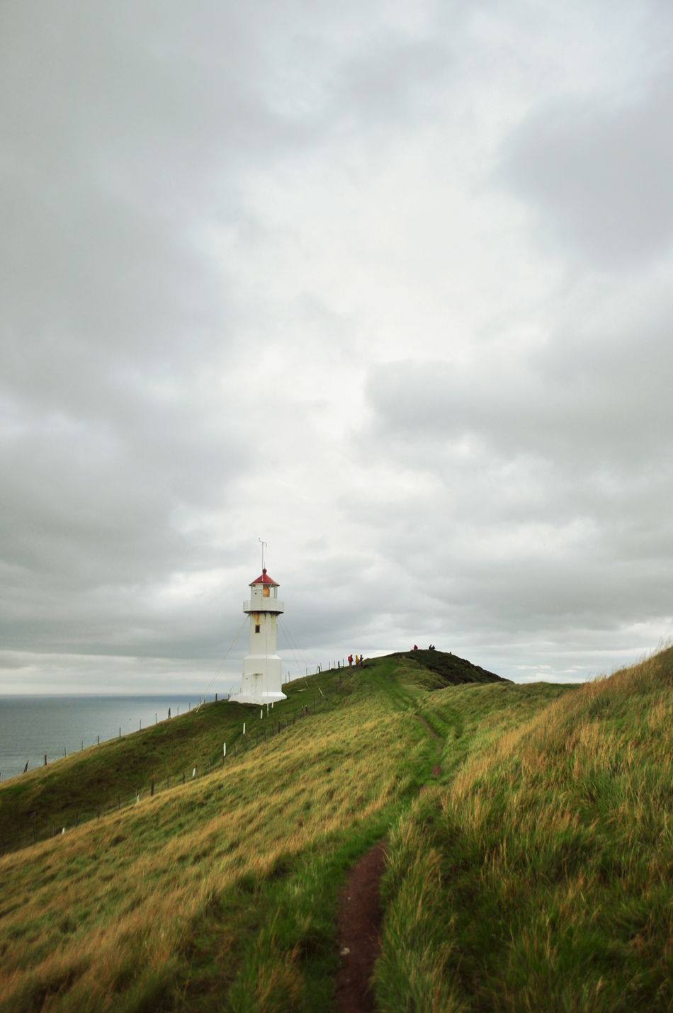 Beauty In Nature Cloudy Day Lighthouse Nature Non-urban Scene Sea Sky Tourism Tranquil Scene Water