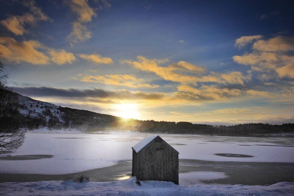 Winter sun and evening strolls Lochan Winterscene Wintersun Frozen Frozenwater Snow Beauty In Nature Sky Cold Temperature Tranquil Scene Winter Nature Tranquility No People Scenics Landscape Sunset Mountain Outdoors Cloud - Sky Architecture Day