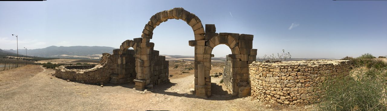 Volubilis - Ancient Capital Of The Roman-Berber Kingdom of Mauretania Desert Landscape Desert Desert City Blazing Sun City Gate MoroccoTrip Morocco Travel Gateway Arch Gate Post Panoramic View Panoramic Photography Panoramic EyeEm Selects Old Ruin History Archaeology Arch Ancient Built Structure Ancient Civilization Architecture Travel Destinations Outdoors Clear Sky No People