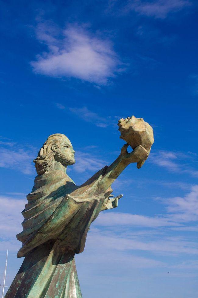 St Jacob Jacob Statue Shell At The Sea Blue Sky Man Holding Shell