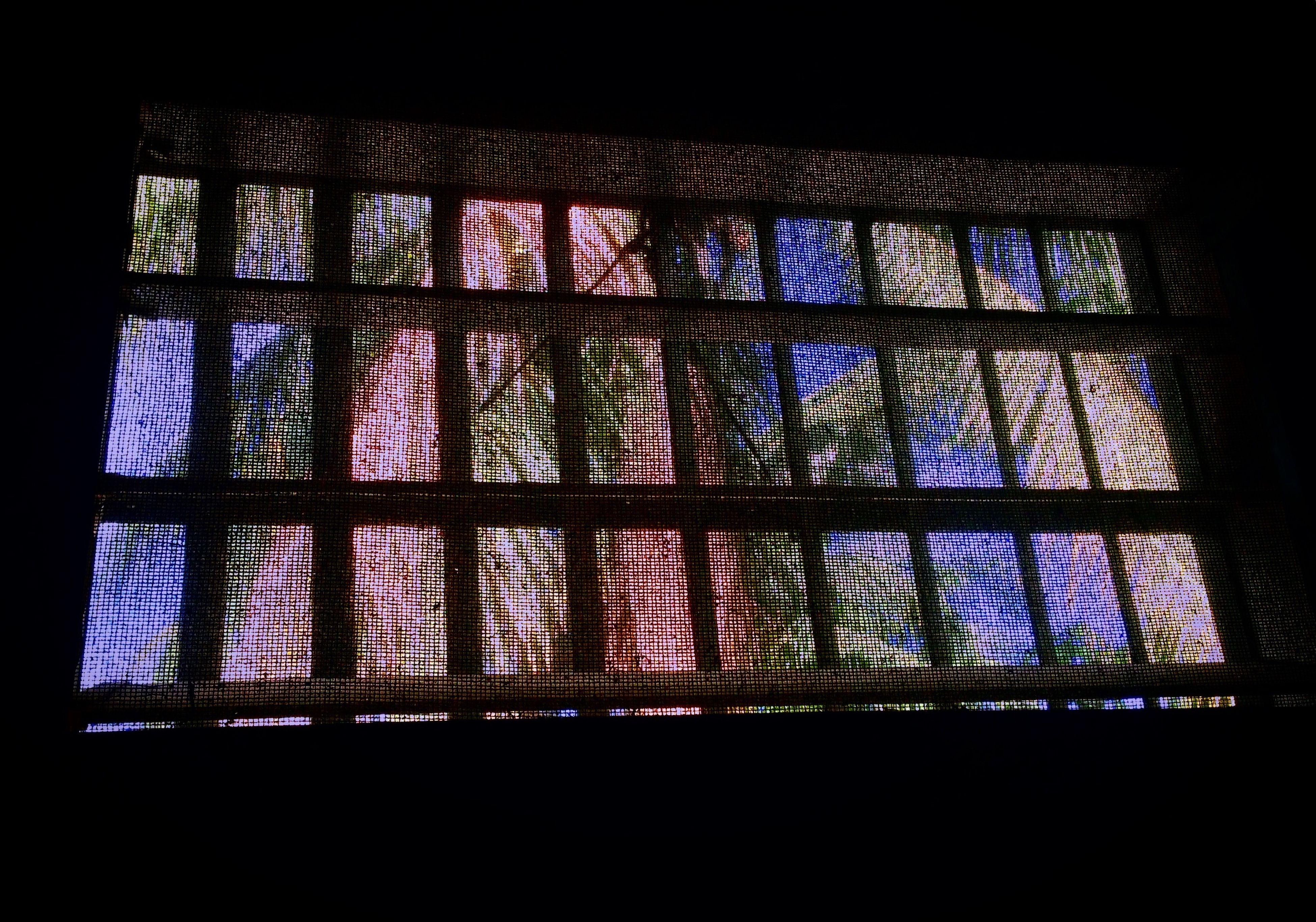 window, stained glass, low angle view, pattern, no people, indoors, multi colored, built structure, grid, architecture, day, close-up, frosted glass, security bar