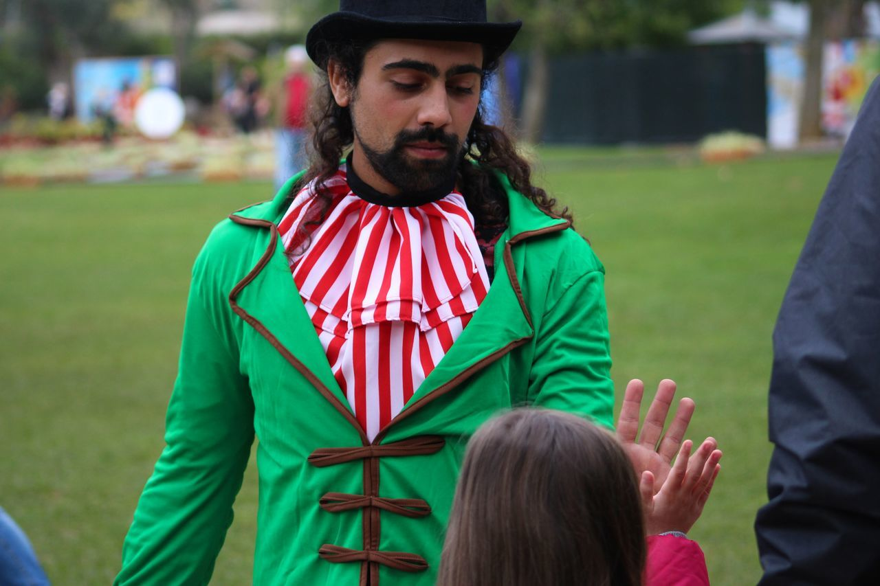 Adult Beard Christmas Close-up Costume Costumes Day Elf Exceptional Photographs Festive Festive Season From My Point Of View Grass Green Green Color Guy Long Hair Men Outdoors People People And Places Person Portrait Real People Young Adult