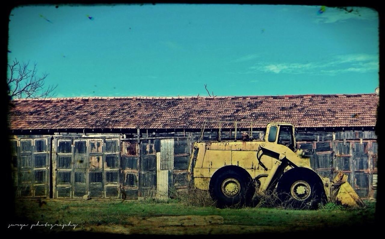auto post production filter, architecture, vignette, land vehicle, day, building exterior, no people, abandoned, built structure, construction site, transportation, outdoors, blue, clear sky, sky