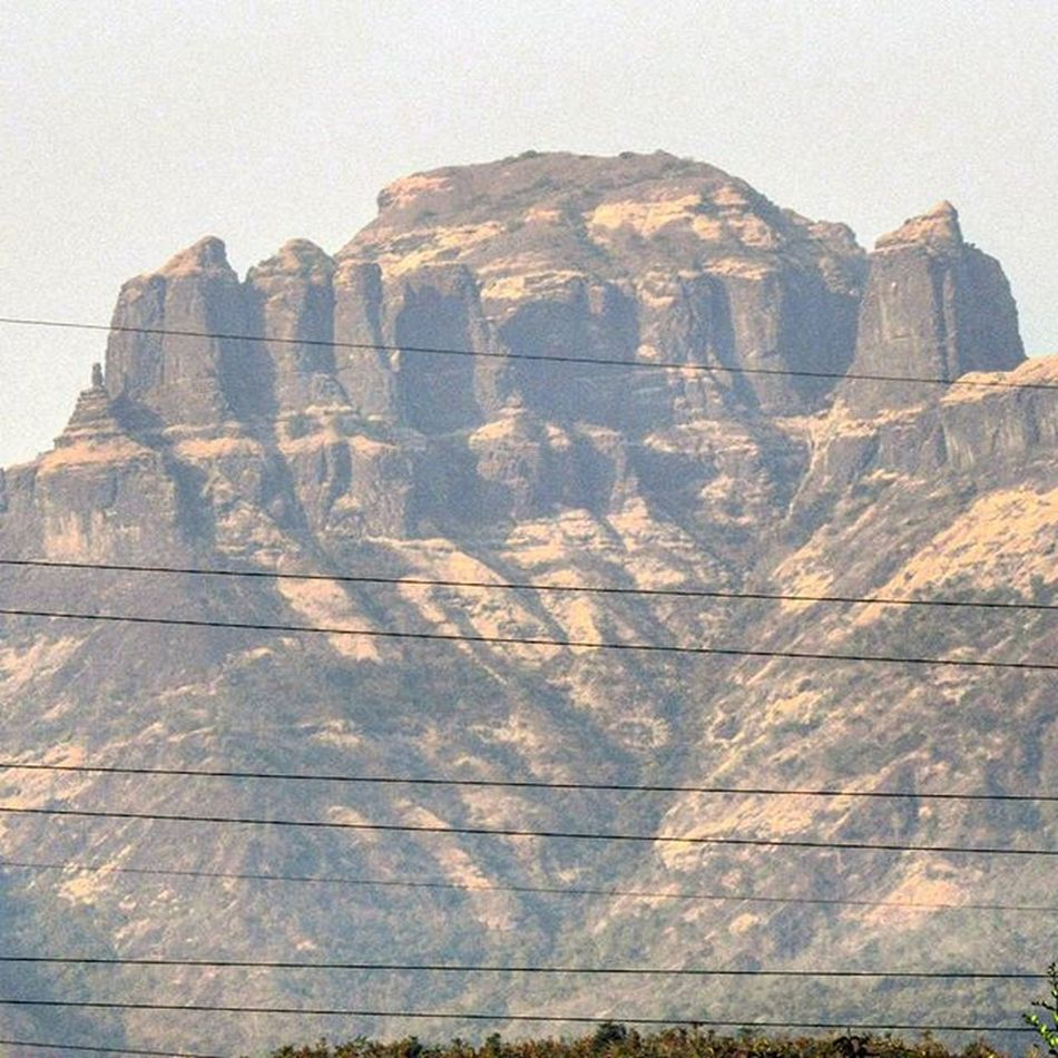 Mahulifort at 2815 ft. It is the highest point in the Thane district This mountain complex is actually a group of two or more hills with common cols and pinnacles.