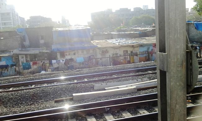 Captured by me Random House Sunlight, Shades And Shadows Sun_collection Perfect Timing Cloudporn #color #reflective Sunrise GoodMorning⛅ Local Traveling Moving Fast Sunlight ☀ Electricity Pole Train Tracks Local Transportation VariousColors Buildings & Sky Slum Area Chawlsofmumbai Random Shots From A Train Window Awesome_captures Sunlight Through Windows Click Click 📷📷📷 by AwesomeAisha_24 in India Maharashtra