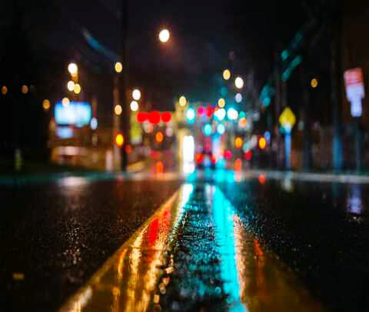 night, street, rain, illuminated, wet, city street, city, city life, weather, road, car, rainy season, traffic, transportation, street light, reflection, outdoors, no people, stoplight, torrential rain, puddle, water, raindrop, yellow taxi, cityscape, defocused
