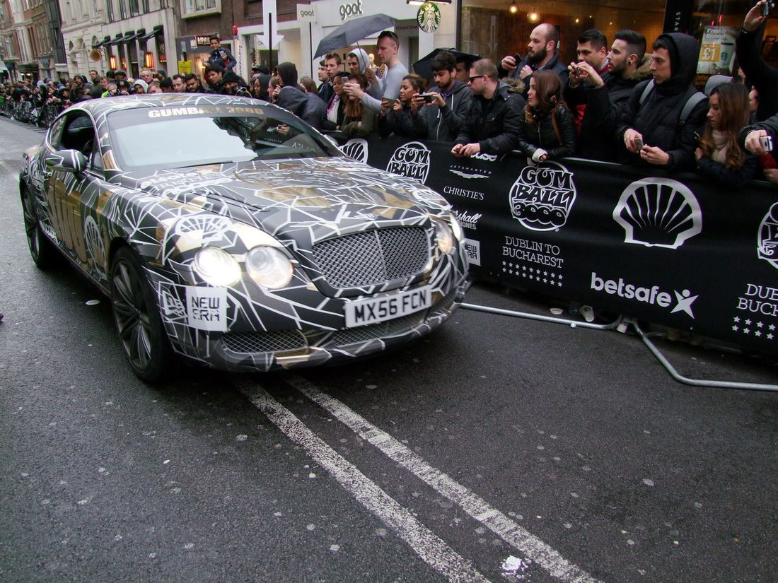 Designer Black Bentley 100 at Stage Finish Gumball 3000 Bentley Body Details Car City Composition Crowd Designer Car Finish Line  Full Frame Fun GB Gumball3000 Large Crowd Logos London Mixed Age Range Mode Of Transport Outdoor Photography Rally Rally Car Road Spectators Sporting Event Uk
