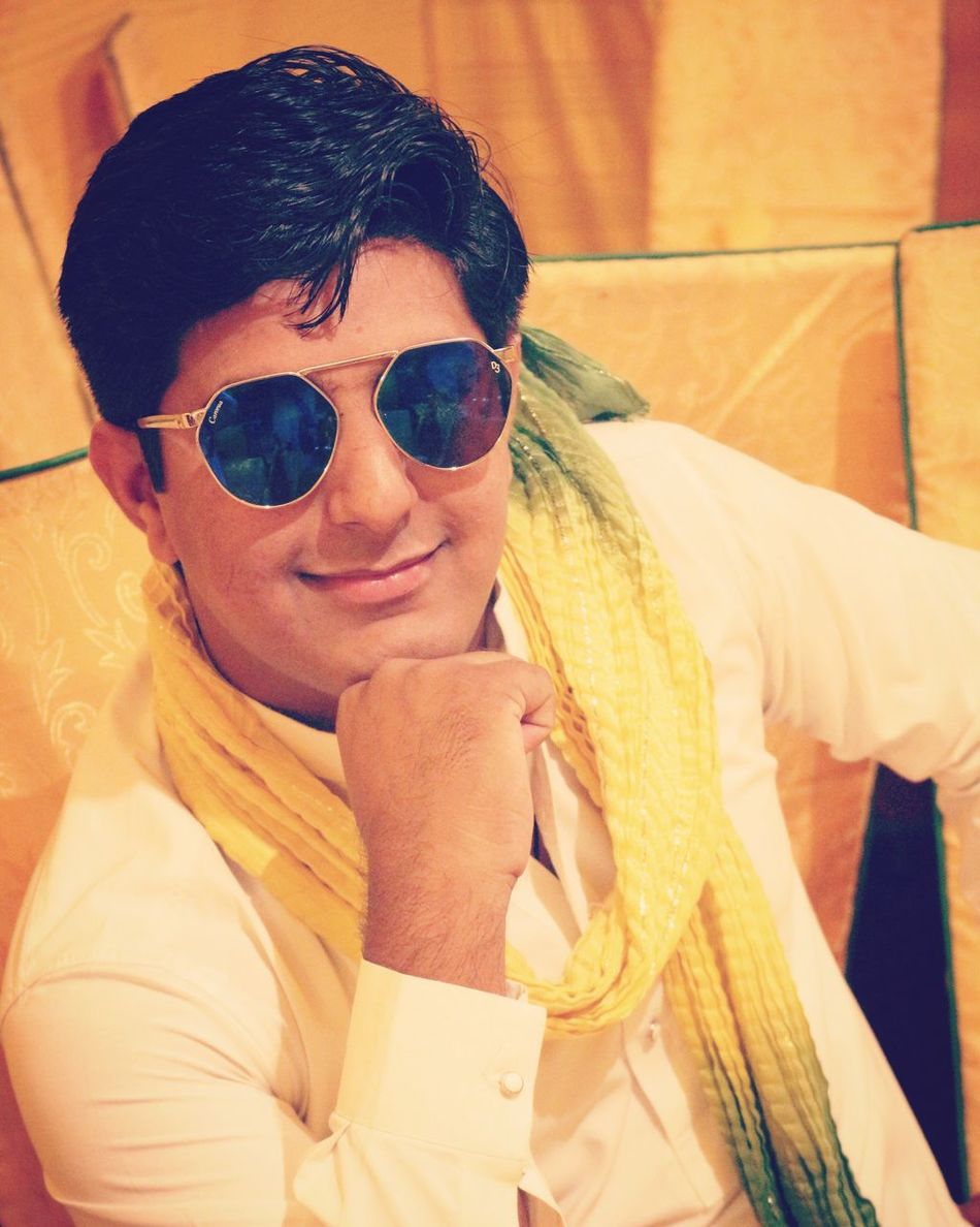 Sunglasses Indoors  Lifestyles Smiling Boy Real People Young Adult One Person Cheerful Close-up Well-dressed Adult People Day Mehndi Whiteandyellow Posing