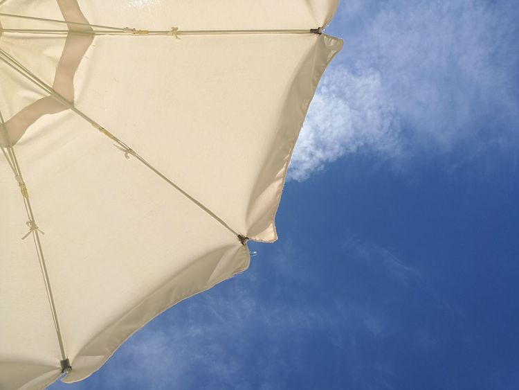 Sky Blue Cloud - Sky Low Angle View Backgrounds Outdoors Summer Day Nature Vacations Holiday Sun Beach Umbrella Sky Umbrellas On The Beach Umbrella White White Umbrella Umbrella Above Sky