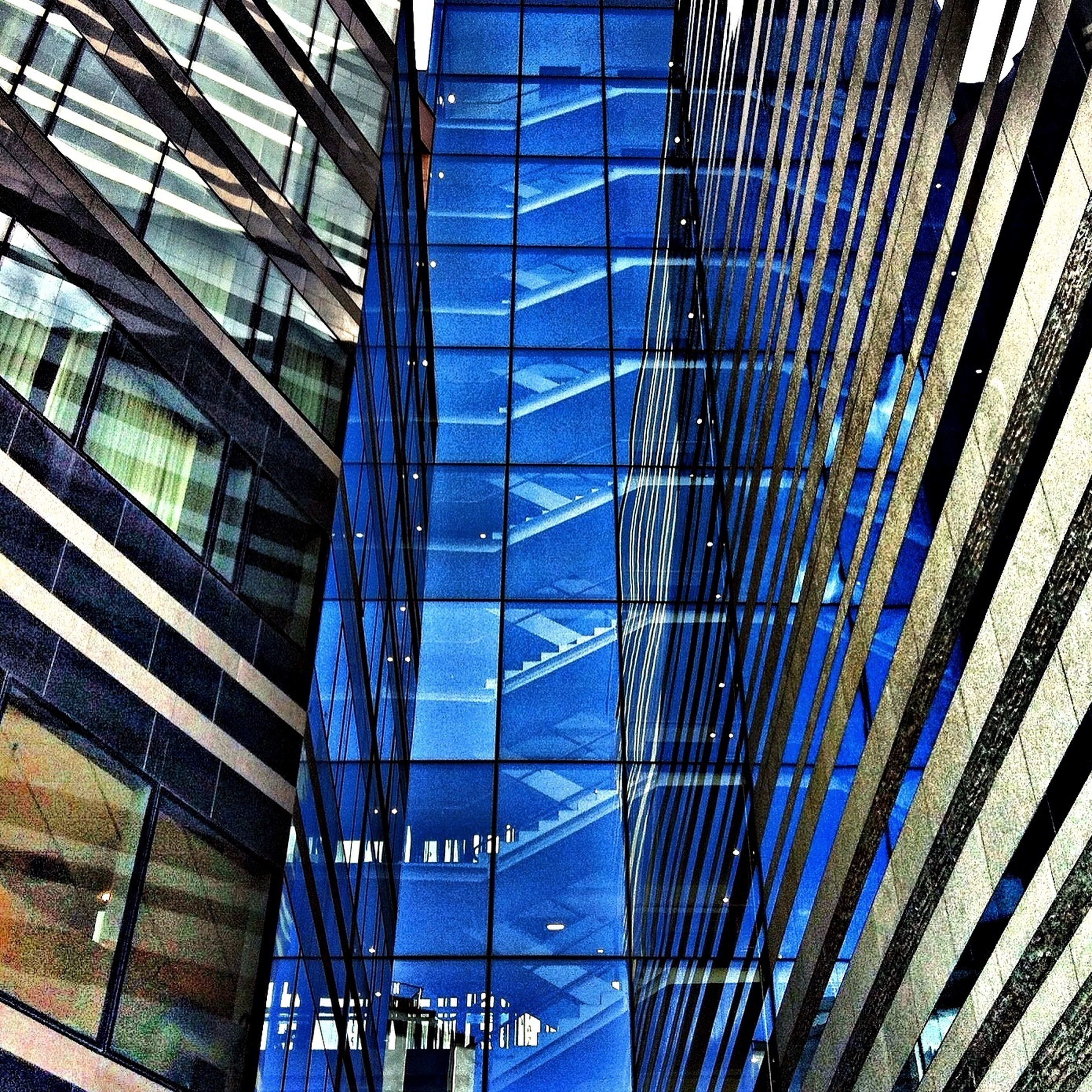 architecture, built structure, low angle view, modern, building exterior, glass - material, blue, pattern, office building, city, full frame, building, reflection, day, backgrounds, architectural feature, grid, no people, tall - high, ceiling