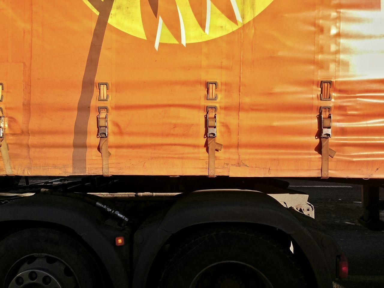 Cropped Image Of Orange Semi-Truck