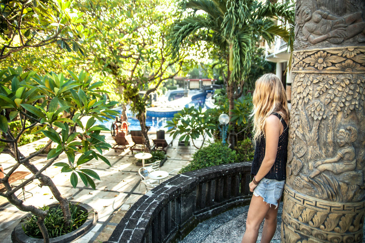 blond hair, young adult, only women, adults only, one woman only, young women, vacations, palm tree, adult, summer, one young woman only, leisure activity, beautiful woman, luxury, people, one person, women, beauty, lifestyles, outdoors, day, tree, luxury hotel, beautiful people, water, standing, swimming pool, nature