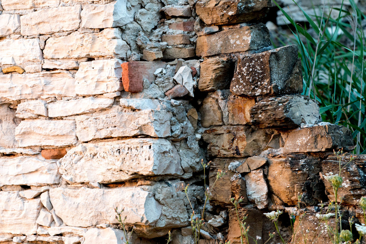 stone material, built structure, brick wall, textured, outdoors, building exterior, backgrounds, green color, architecture, nature, industry, rubble, no people, day, close-up, time