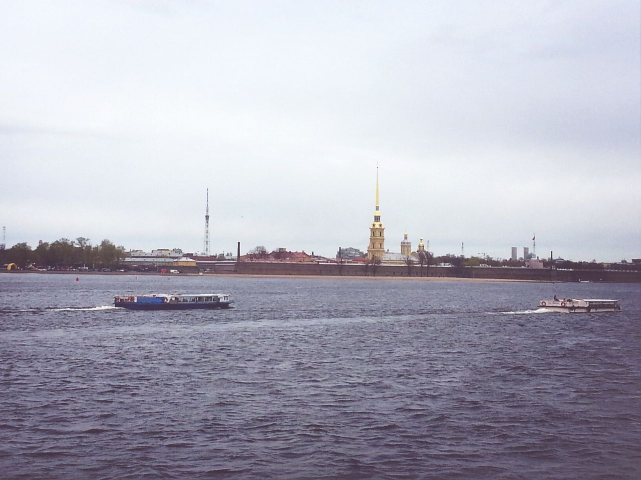 Peter And Paul Cathedral In Zayachy Island Against Sky With Neva River