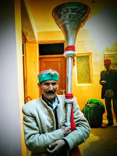 A Himachali man holding a musical instrument People Himachal Culture Musical Instruments Local People Folk Musicians Hill Culture India PahariCulture Innocence Himachalitopi Himachali People Fairs In India Shivratri Mandi Himachal Fine Art Photography Home Is Where The Art Is People Photography