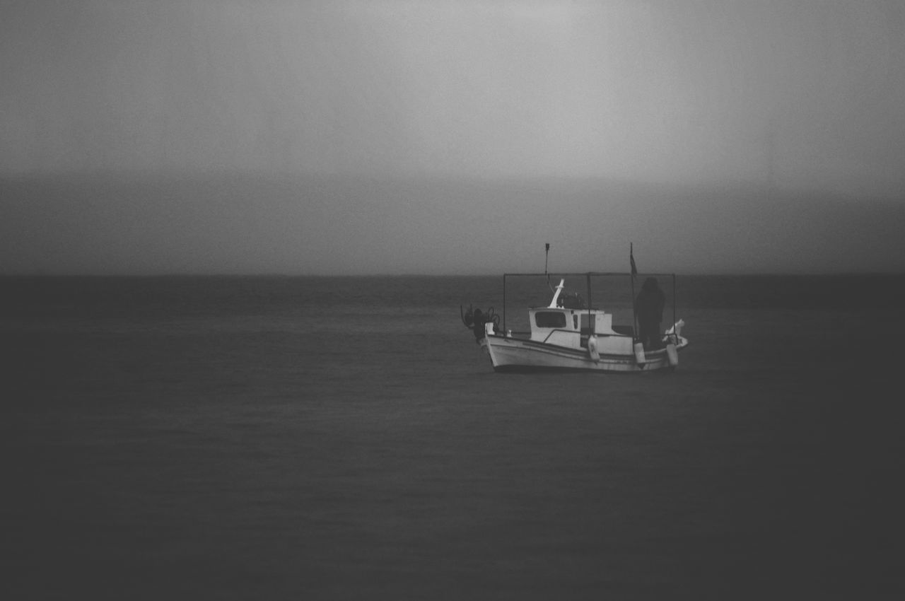 Blackandwhite Photography Nautical Vessel Fisherman Islandlife Beauty In Nature Sea View Tranquil Scene Seascape Calm Sea Simple Photography Blackandwhite Fishing Boat Calmness Sailing Horizon Over Water Tranquility Beauty In Nature Black And White Fishermen's Life Moody Weather Getting Inspired Darkness Dark Photography - Greek Islands Greece