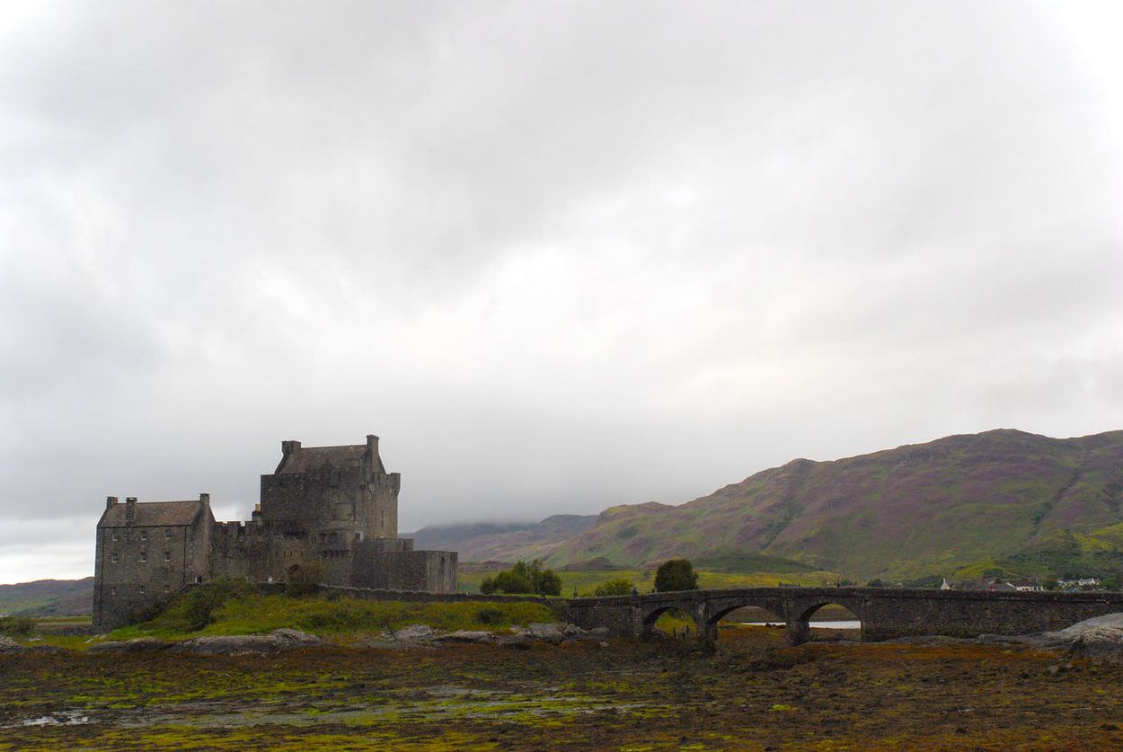 A bleak looking Eilean Donan Castle, Kyle of Lochalsh, Scotland. Architecture Bridge - Man Made Structure Building Exterior Built Structure Castle Cloud - Sky Eilean Donan Castle History Kyle Of Lochalsh Mountain No People Outdoors Scotland Travel Destinations