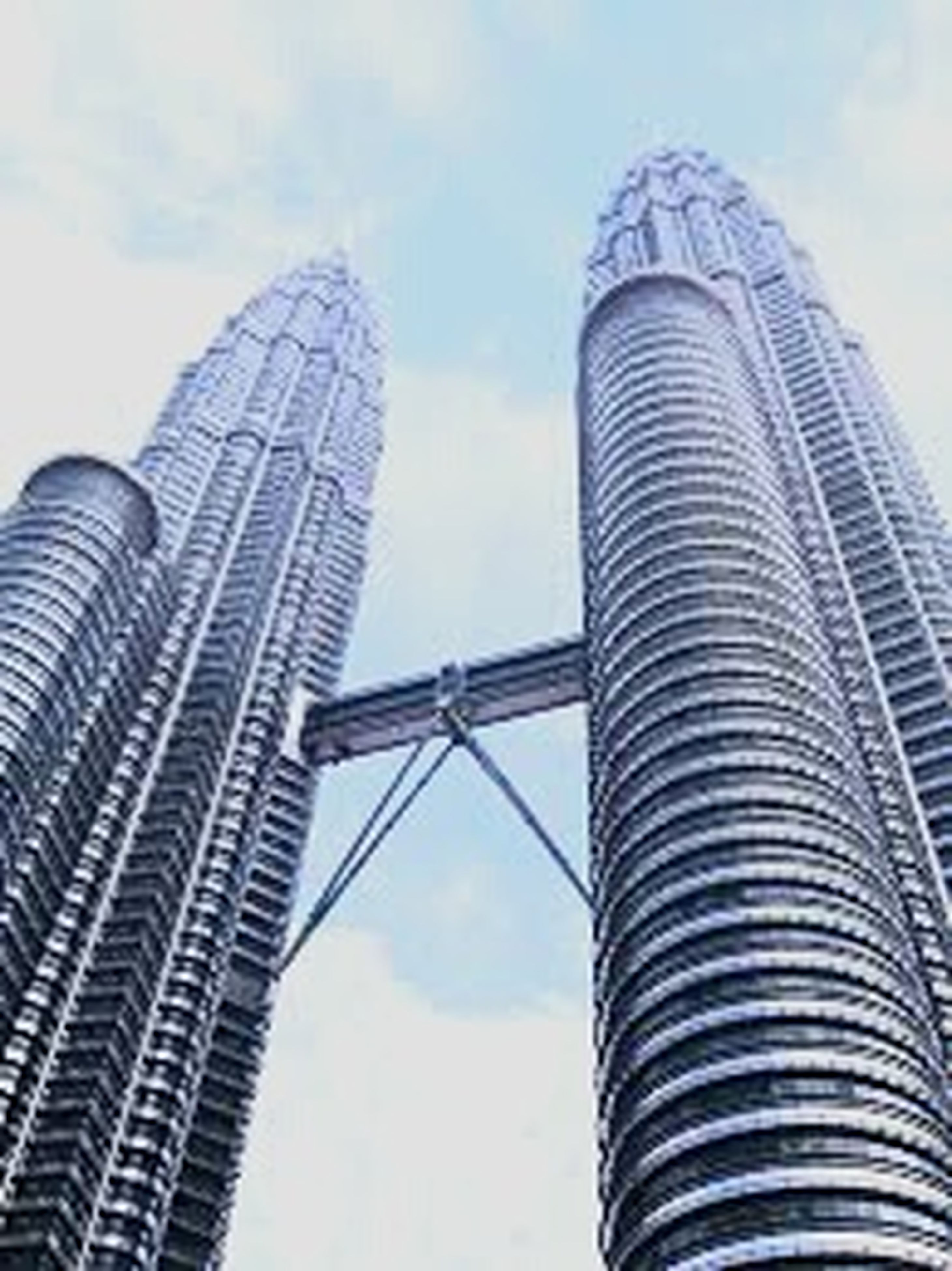 low angle view, architecture, built structure, tall - high, building exterior, skyscraper, tower, modern, city, sky, office building, capital cities, famous place, travel destinations, international landmark, cloud - sky, glass - material, tall, day, building
