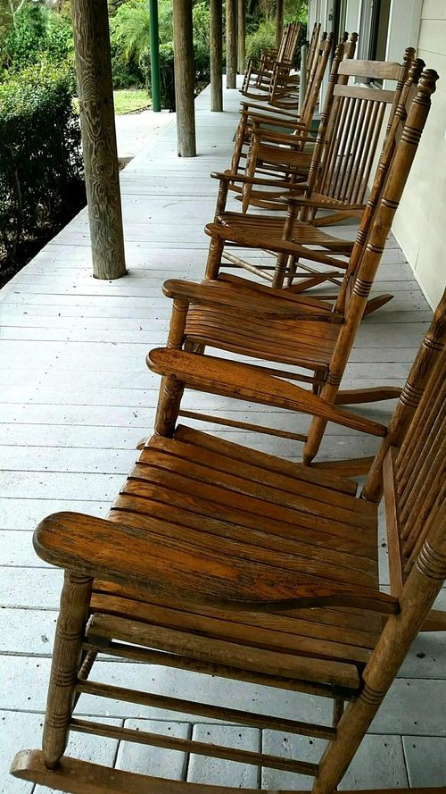 rock 'n row Rocking Chair In A Row Veranda Rocking Chairs Have A Seat Group Of Objects Wooden Chair