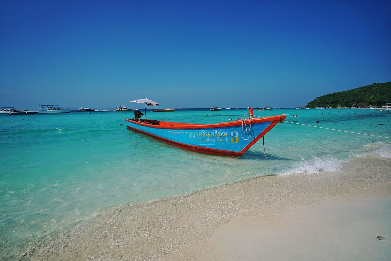 Thailand Photos Sea Beach Blue Sunny Sky Sand Clear Sky Nautical Vessel Horizon Over Water No People Tranquility Travel Destinations Water Waving Travel Tranquil Scene Outdoors Nature Boat Oceanside Ocean View Vacations Beach Day Streamzoofamily