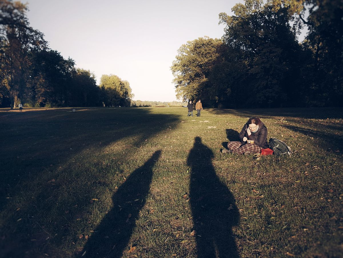 Shadow time... Shadow Shadow Play Light And Shadow Streetphotography Streetscene Picknick Woman Enjoy The New Normal Sitting In The Grass Autumn Autumn Light Adapted To The City Mobile Conversations Women Around The World TCPM