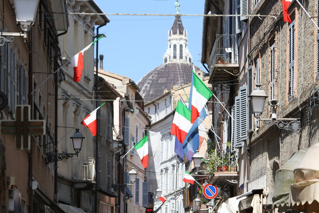 Architecture Building Building Exterior Built Structure Capital Cities  Cathedral City City Life Culture Day Italian Flags Loreto Marche Low Angle View Modern Multi Colored No People Outdoors Residential Building Sky Tall Tall - High Travel Destinations