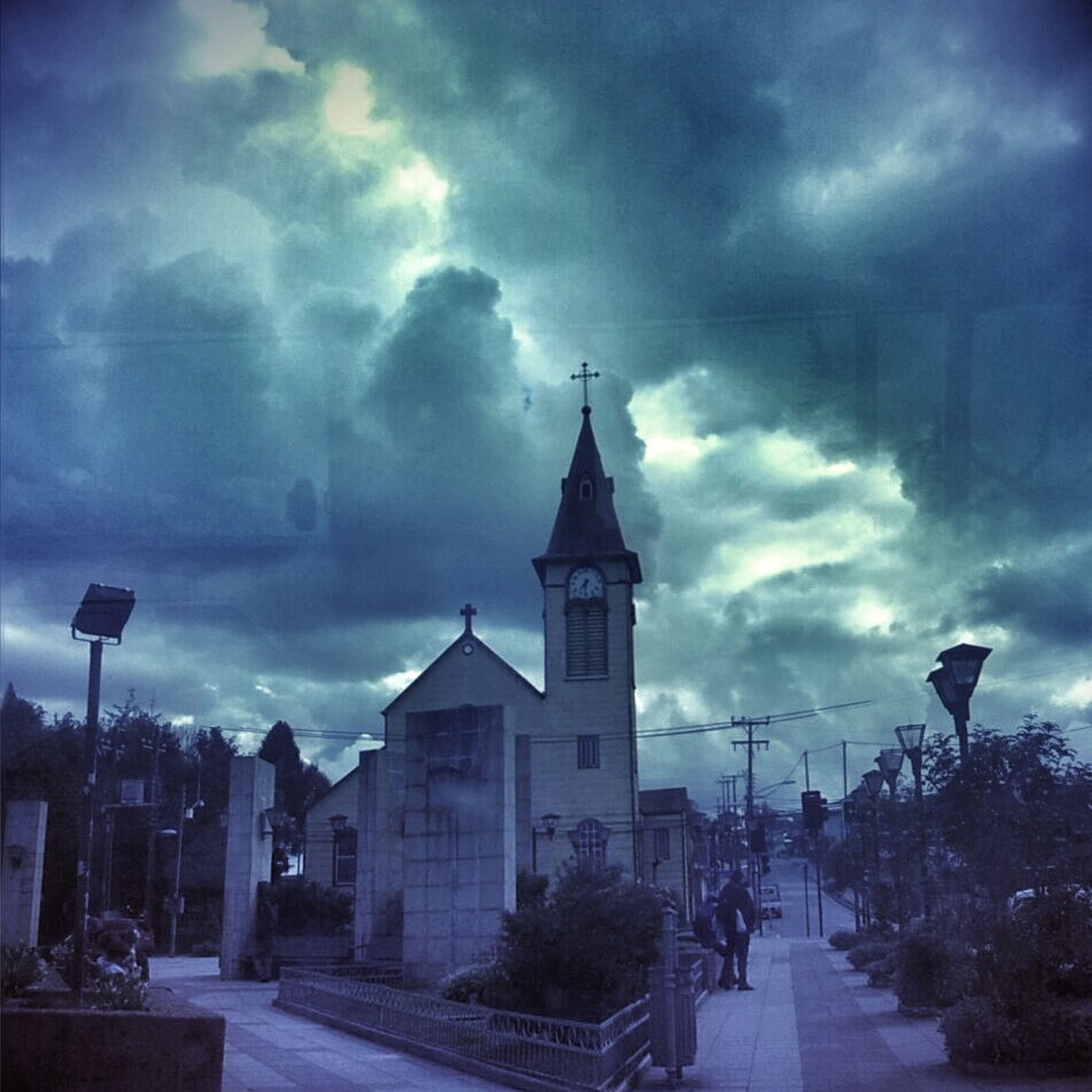sky, cloud - sky, building exterior, cloudy, road, transportation, built structure, architecture, street, car, street light, land vehicle, the way forward, weather, cloud, mode of transport, overcast, incidental people, outdoors, storm cloud